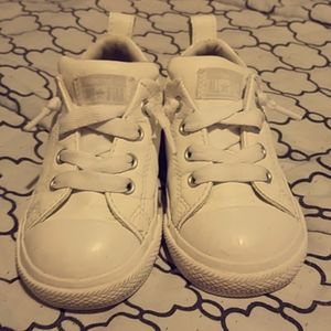 All white Converse toddler shoes